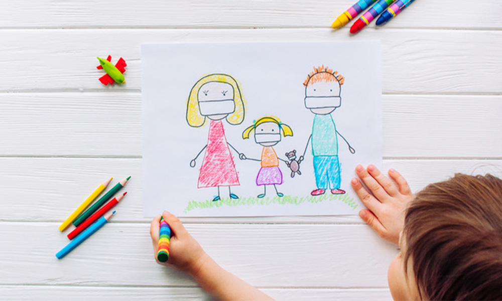Child drawing father's and mothers day
